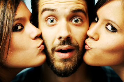 Lucky guy gets a kiss from two cute twins. Is that a test?